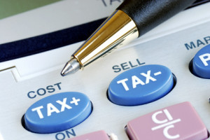 Determine the tax and the cost with a calculator