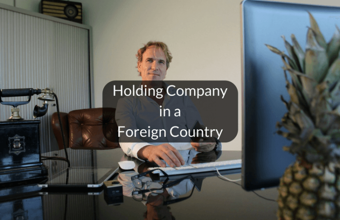 Incorporation of holding company in another country
